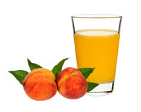 Peach juice in a glass with peaches Royalty Free Stock Photos