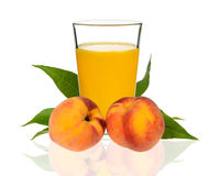Peach juice in a glass with peaches Royalty Free Stock Photo