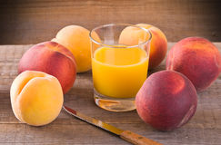 Peach juice. Image of a group of peaches with juice Royalty Free Stock Photography