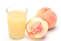 Peach juice and peach Royalty Free Stock Image