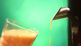 Peach juice. On a green hue background stock video footage