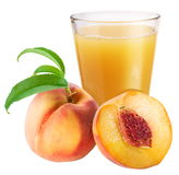 Peach juice with ripe peach. On a white background Royalty Free Stock Image