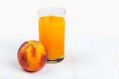 Peach juice and ripe peache Stock Photography