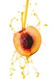 Peach juice splashing Royalty Free Stock Images