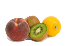 Peach, kiwi fruit and lemon Royalty Free Stock Photo