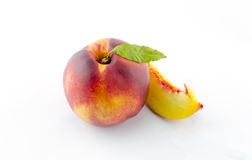 Peach. With leaf isolated on white Royalty Free Stock Images