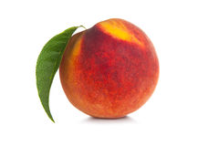 Peach with leaf Stock Images