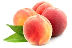 Peach with leaf isolated. Peach with leaf isolated on white background stock photography