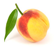 Peach with leaf on white Royalty Free Stock Photography