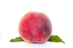 Peach with leaf on white Royalty Free Stock Images