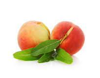 Peach with leaves isolated on white background.  Royalty Free Stock Image