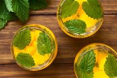 Peach, Lemon Balm and White Wine Punch Stock Photo