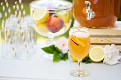 Peach lemonade on the drink station Royalty Free Stock Photo