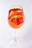 Peach lemonade with oranges and strawberries Stock Image