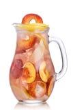 Peach lemonade pitcher Royalty Free Stock Photography