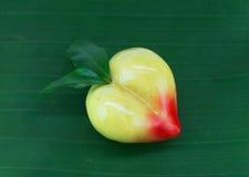 Peach lookchoob thai dessert on banana leaf Royalty Free Stock Images