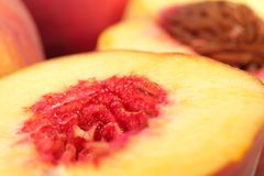 Peach macro. Half a peach without stone closeup Royalty Free Stock Images