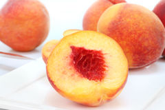 Peach macro on white plate Royalty Free Stock Photo