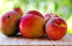 Peach and mango fruits Royalty Free Stock Photos