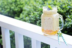 Peach and mango smoothie outdoor in the morning Stock Image