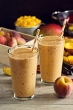 Peach Mango Smoothies with Fresh Ingredients Stock Image