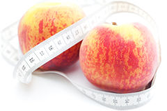 Peach and measure tape Stock Photography