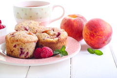 Peach melba cakes. And cup of tea stock images