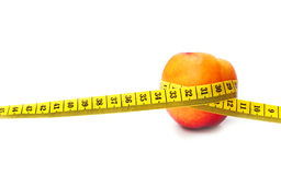 Peach and meter isolated. On white Stock Photography