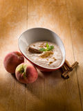 Peach mousse with cinnamon Royalty Free Stock Images