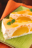 Peach mousse with tangerines Stock Images