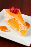 Peach mousse with tangerines Royalty Free Stock Photography