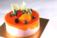 Peach mousse with tangerines and jelly. Stock Images