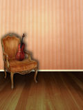 The Peach Music Room. A peach music room with hard wood floors, plush chair and a violin Royalty Free Stock Photography