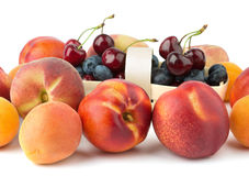 Peach, nectarine, apricot. On background cherries isolated on white background Stock Photo