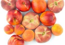 Peach, nectarine, apricot. On a white background Stock Photos