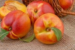 Peach or nectarine on burlap background Royalty Free Stock Photos