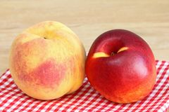 Peach and Nectarine on a checkered cloth Stock Images