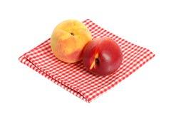 Peach and Nectarine on a checkered cloth Stock Photos