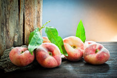 Peach on old wood Stock Images