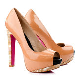 Peach-orange high heel shoes isolated on white background. Royalty Free Stock Photo