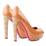 Peach-orange high heel shoes isolated on white background. Royalty Free Stock Images