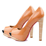 Peach-orange high heel shoes isolated on white background. Stock Photo