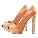 Peach-orange high heel shoes isolated on white background. Stock Photo
