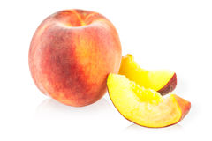 Peach and peach slices Stock Images