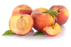 Peach peaches slice half fruit fruits leaves isolated on white Royalty Free Stock Image