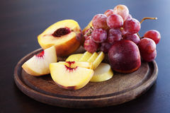 Peach, pear and grapes Royalty Free Stock Photos