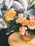 Peach Peony Flowers and Pink Poppy Flowers in Vase on Table Centerpiece Royalty Free Stock Photo