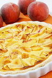 Peach pie. Clafoutis with fresh peches Stock Images
