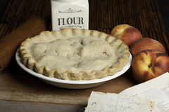 Peach pie. On cutting board with peaches Royalty Free Stock Photography
