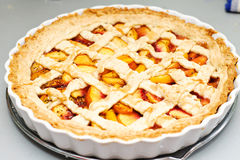 Peach pie. Homemade peach pie with caramel stock photos